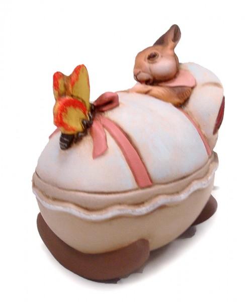 Wiege mit Hasenbaby und rosa Schleife
